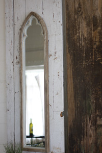 arched wood framed mirror