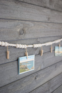 wooden garland with clothes pins
