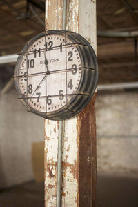caged metal <i>new york</i> factory clock