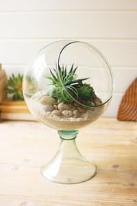 slanted opening glass globe